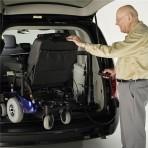 Big-Lifter-man-moving_-powerchair-in-van2
